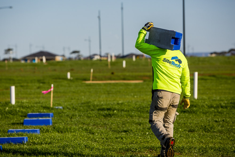 Sitetech commercial photography man walking with high vis and gloves