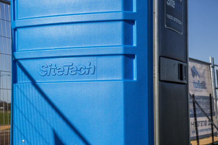 sitetech blue portable toilets closeup of logo for commercial photography