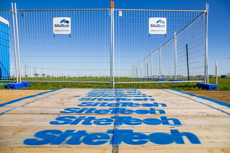 construction fencing with flexitech crossovers on a bright blue sky for commercial photography branding