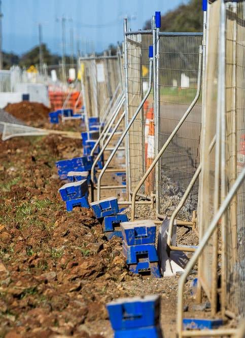 sitetech commercial photography fencing construction site dirt and road