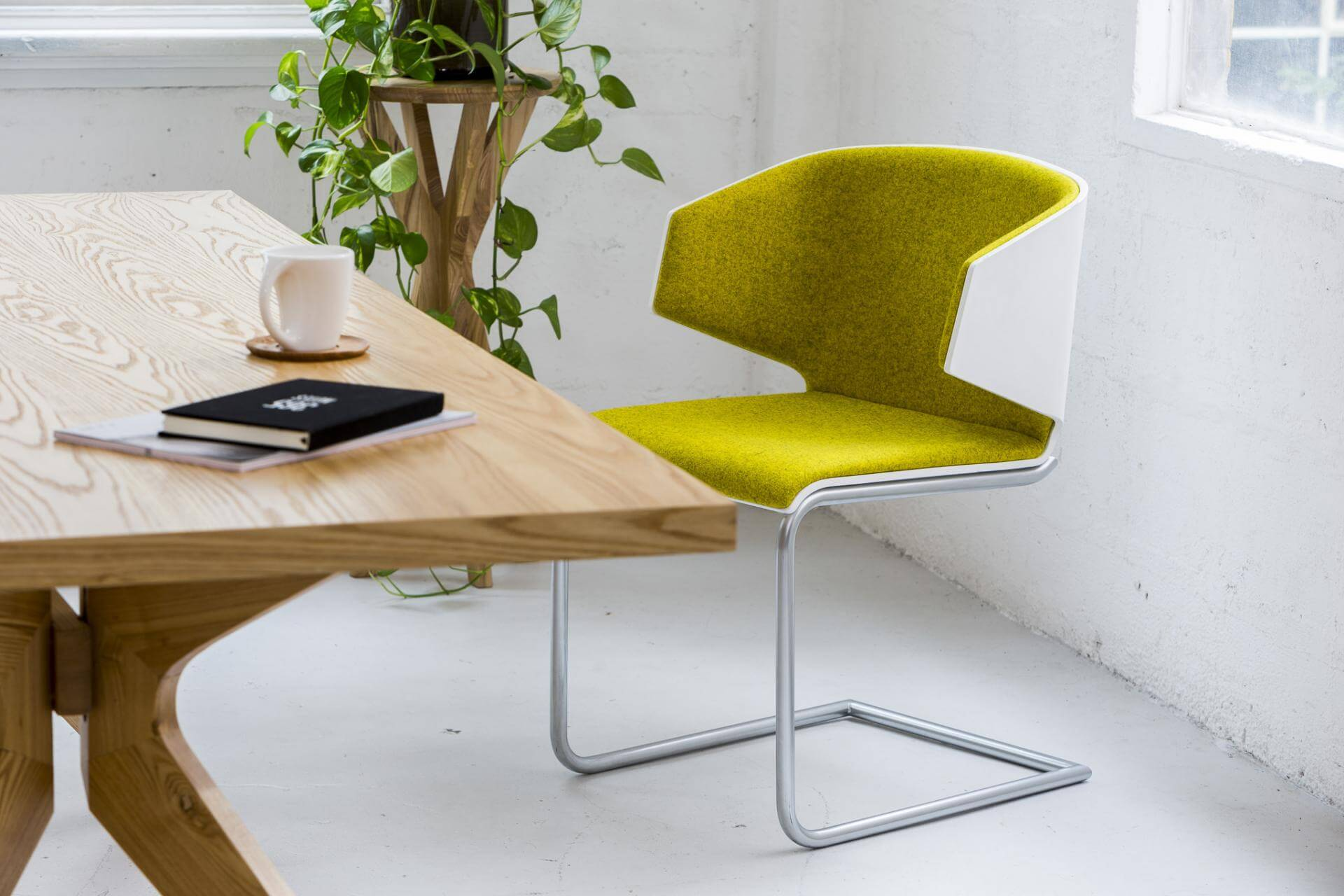 modern yellow chair with table and props for ecommerce product photography