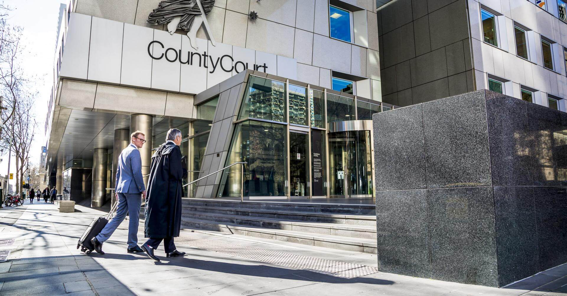 lawyer and barrister walking into courtroom building in Melbourne for branding photography