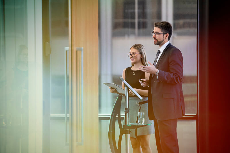 lawyers presenting in boardroom with lectern posing for workplace photography